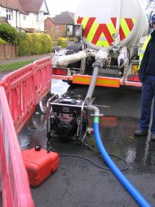 Pumping water from a tanker into the Constable Drive Reservoir.